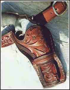 Carved holster and matching cartridge belt with snakeskin inlay
